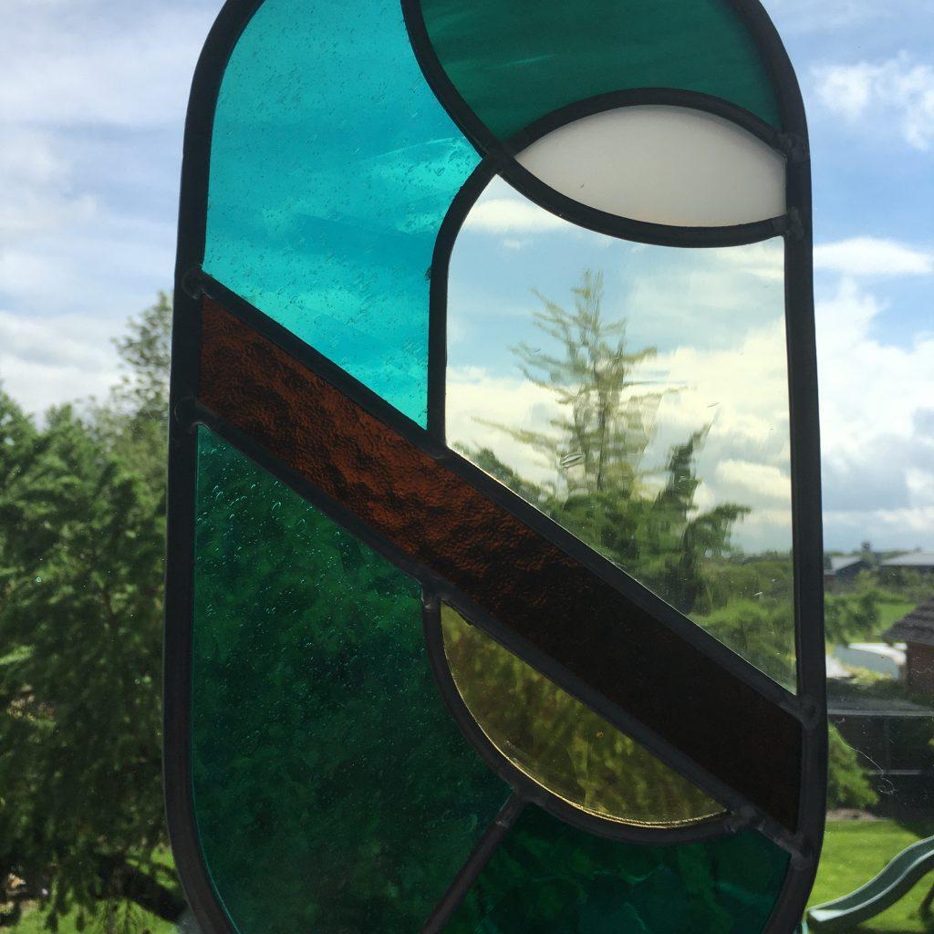 Grote ovale glas in lood raamhanger